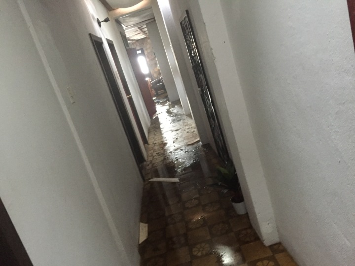 hurricane maria damage to apartment in hall