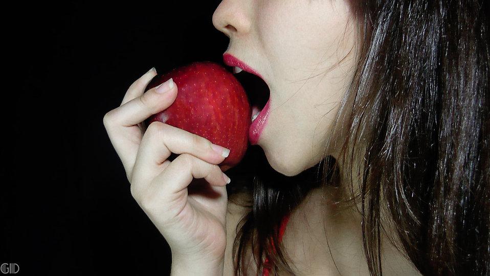 woman biting into apple, forbidden fruit blog