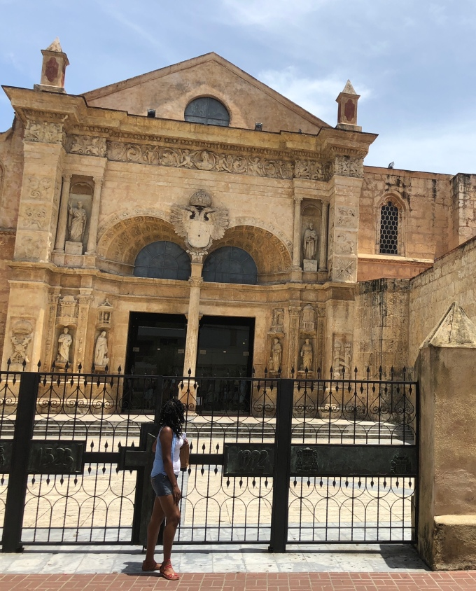 ashley amor standing in front of a cathedral in Dominican Republic