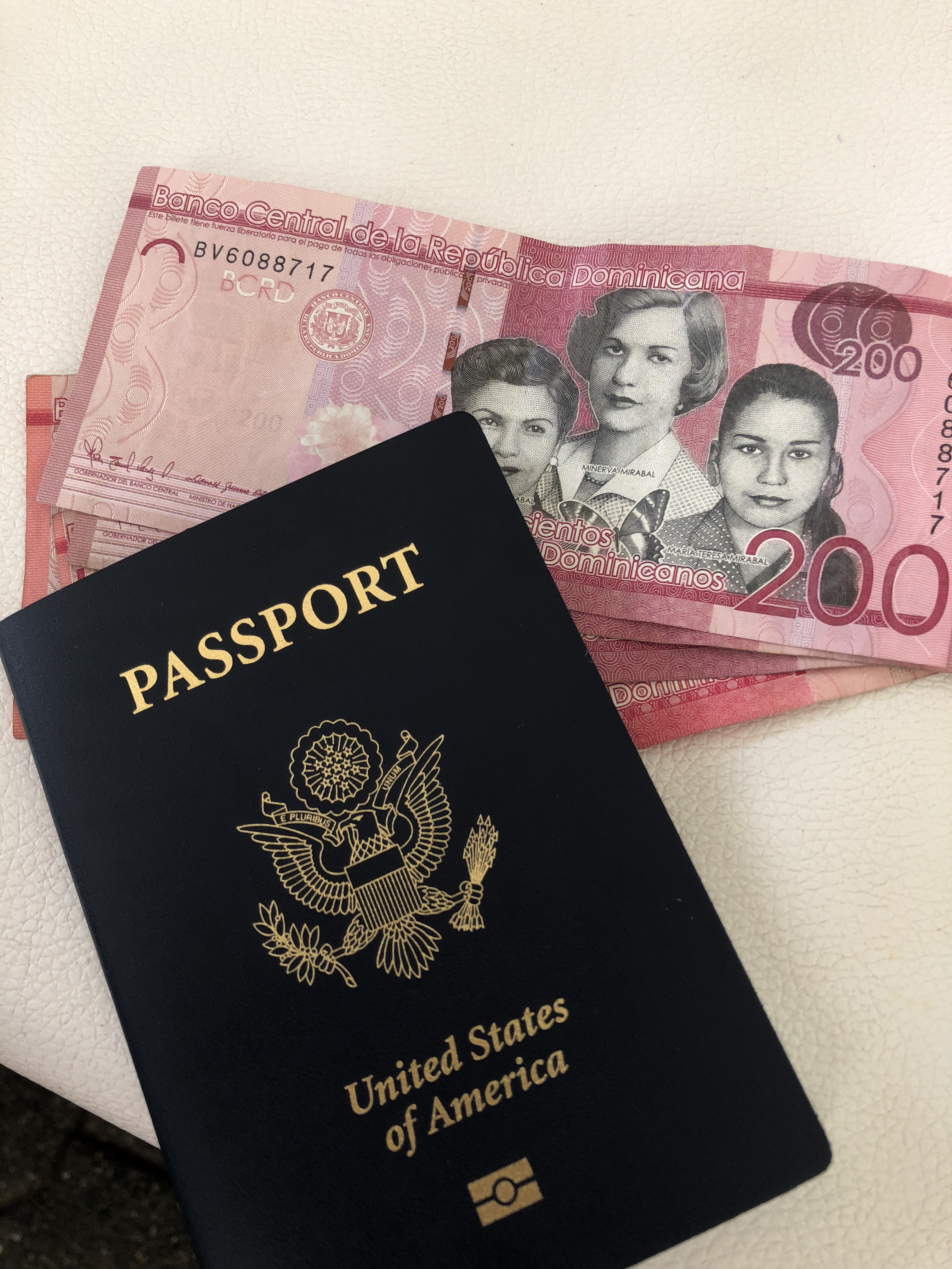 passport and dominican pesos while traveling on a budget